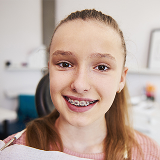 Young girl with pediatric orthodontics