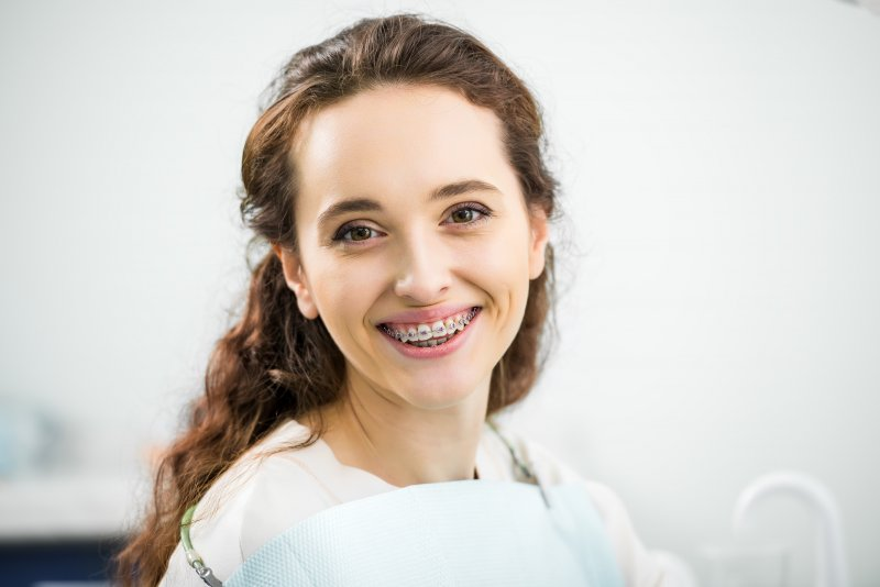 Closeup of woman with braces smiling
